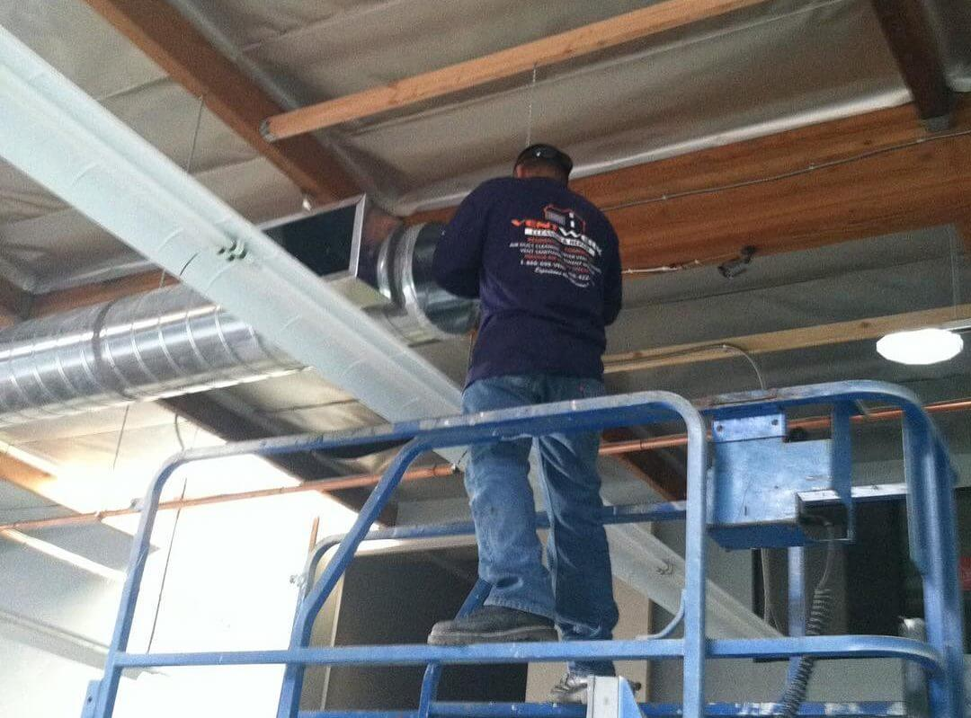 San Jose HVAC technican cleaning commerical ductwork