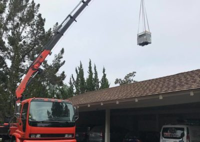 Installing a Roof HVAC unit via crane in San Jose